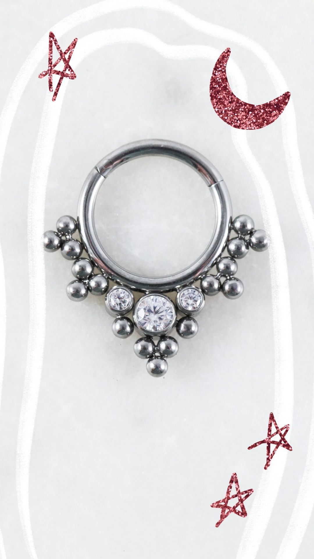 The Alannah Hinged Seam Ring is an intricate beauty featuring two crystals in the center of a beaded design. Its great for your daith, septum, lobe, or helix/cartilage piercings!
