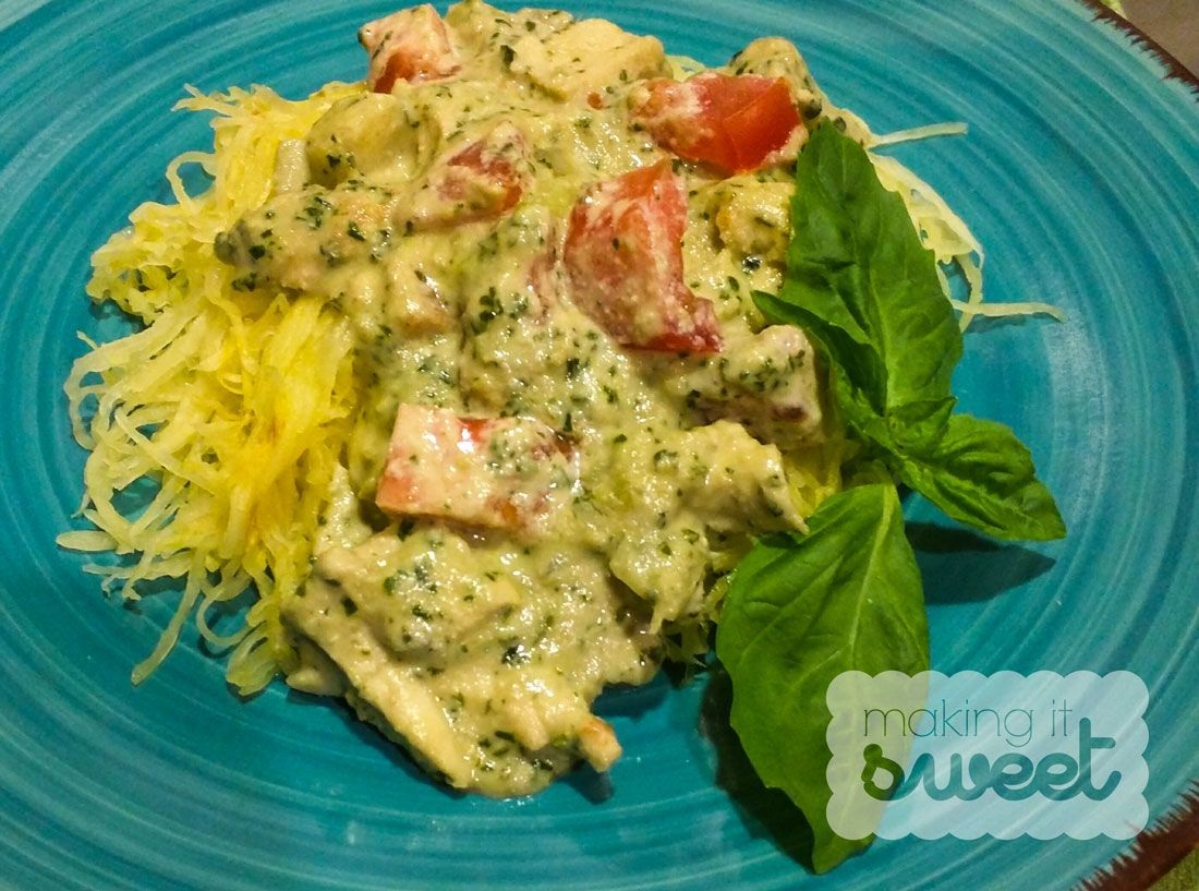 Gluten-Free, Paleo-Friendly Creamy Pesto Chicken on top of Spaghetti Squas
