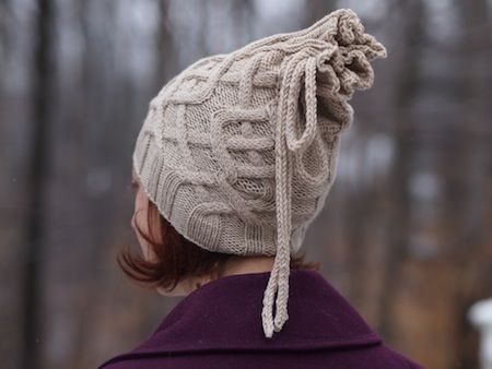Quirky and fun cable knit hat pattern by Fiber Space. Find the free pattern here: link