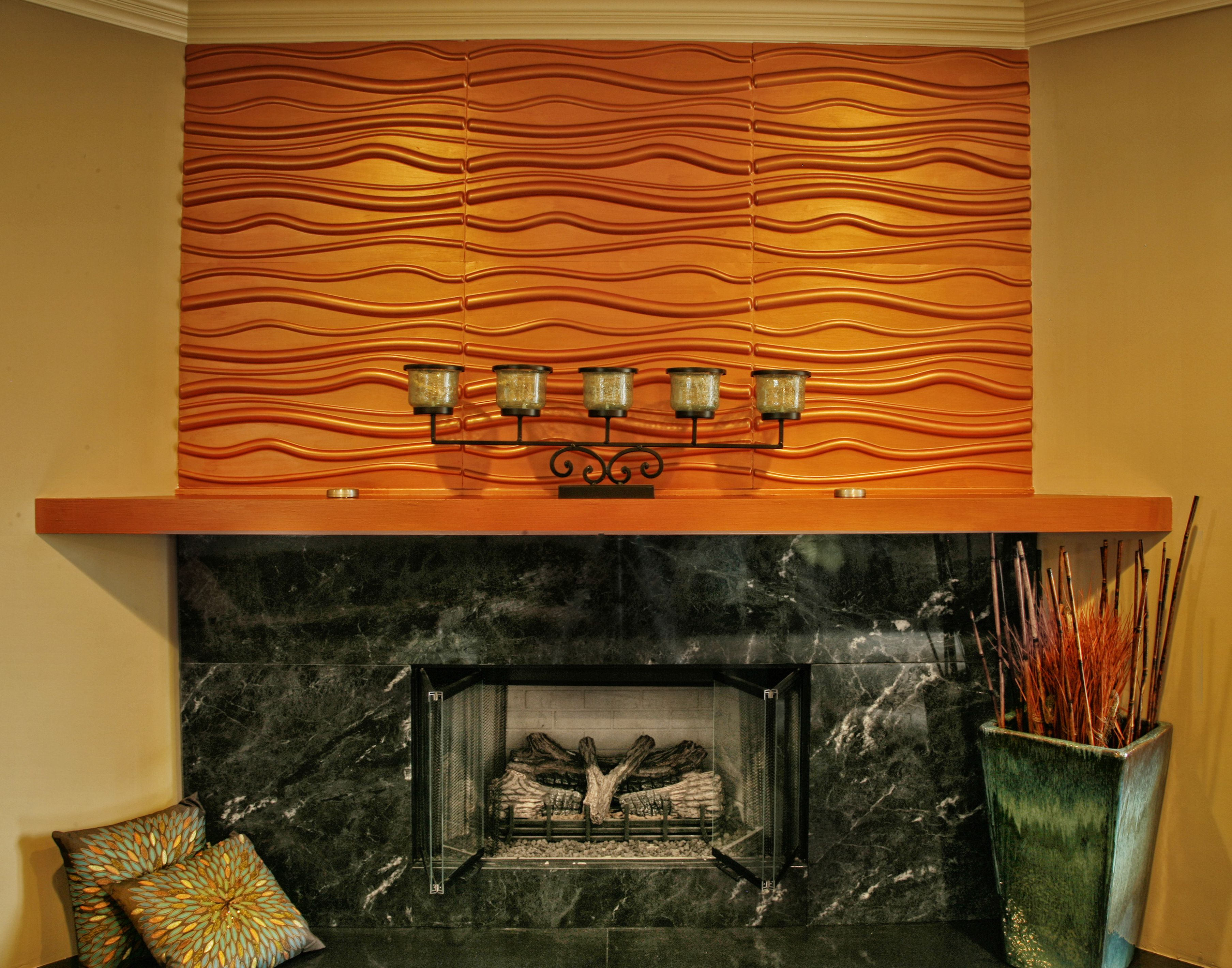 Copper Fireplace Mantel Copper Colored Textured Wall Panels Above A Portuguese Granite