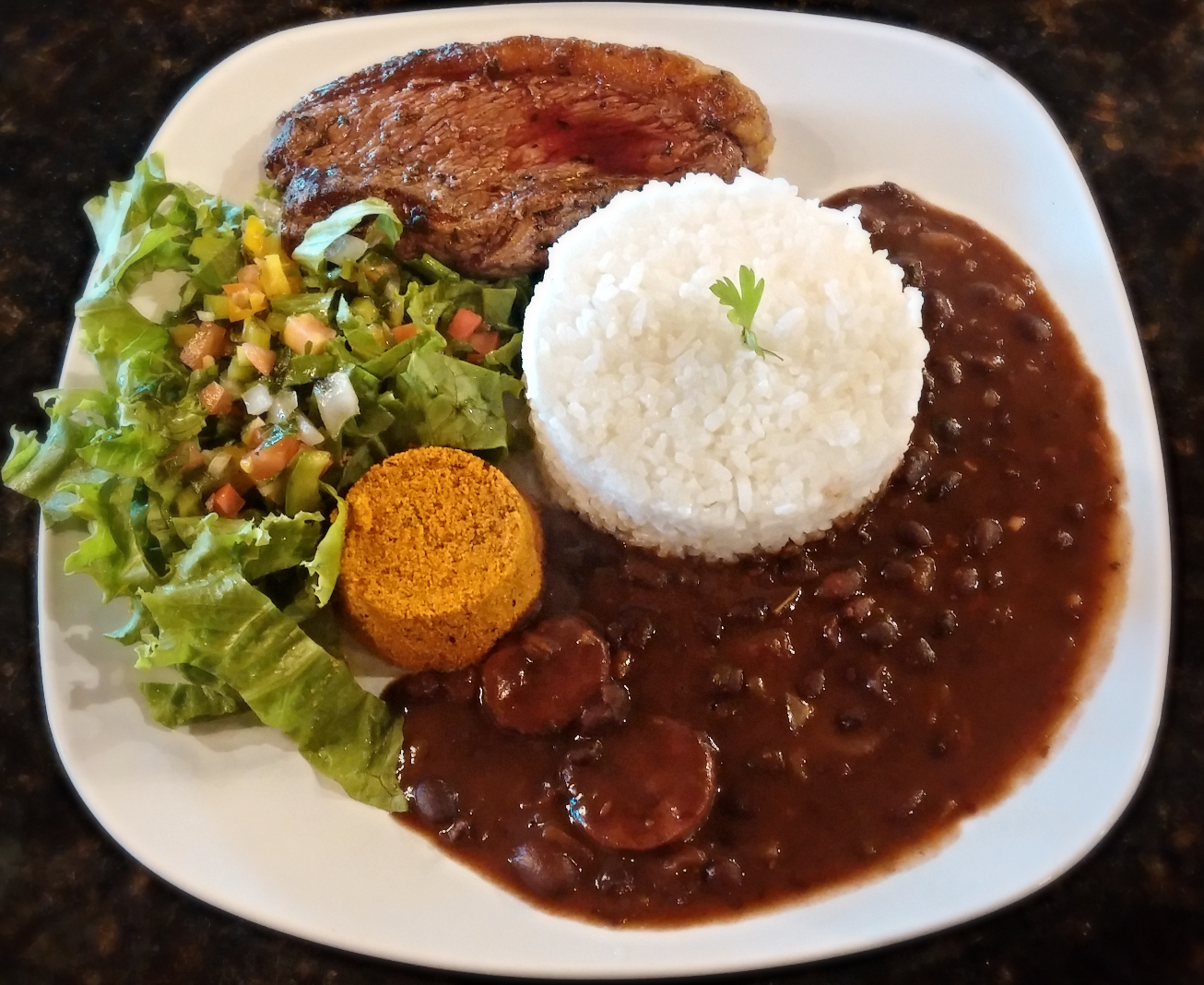 Picanha Square Meal served with a side of Jasmine rice, Gaucho's signature beans stew, House salad and Farofa.