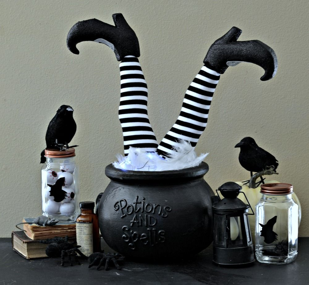 Easy DIY witches feet in a cauldron with twinkle lights make a - Inexpensive Halloween Decorations