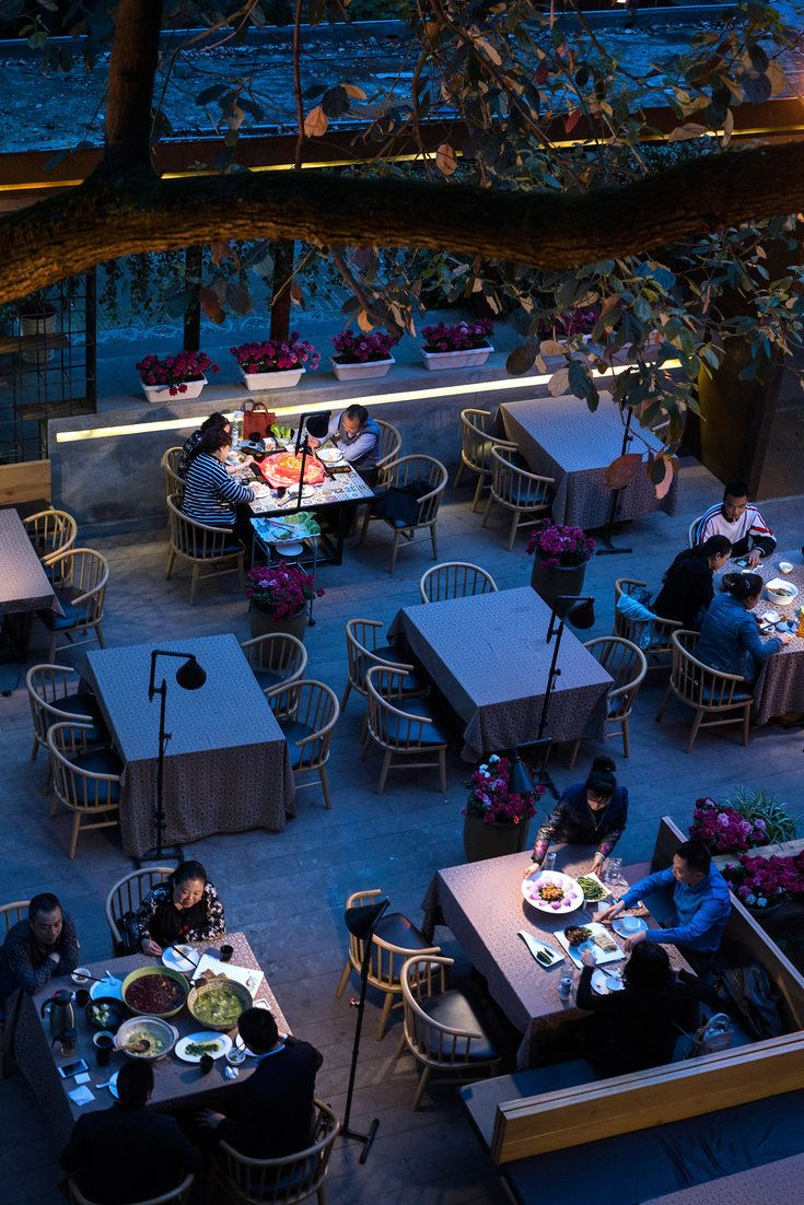 """""""You do have to maintain tradition, but it's not a display in a museum,"""" said Yang Wen, a chef whose restaurant, Lotus Shadow, features refined dishes, like braised shrimp infused with jasmine tea, that are a world away from the homespun fare favored by old-school revivalists. (Photo: Adam Dean for The New York Times)"""