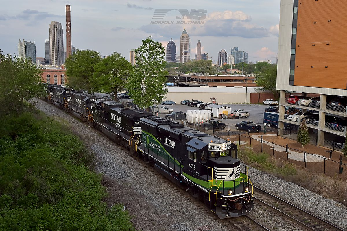 Welcome to ‪#‎Atlanta‬! ‪#‎NorfolkSouthern‬ GP33ECO #4715 makes its first appearance in its new hometown as it leads Piedmont Division local P76 towards Inman Yard. The midtown skyline can be seen in the distance, including a bit of Norfolk Southern's David R. Goode headquarters building. 4715 was towed on several different trains from Altoona, and delivered early in the morning to the satellite yard in Chamblee on train 348 from Linwood. One of P76's duties this afternoon was to move train…