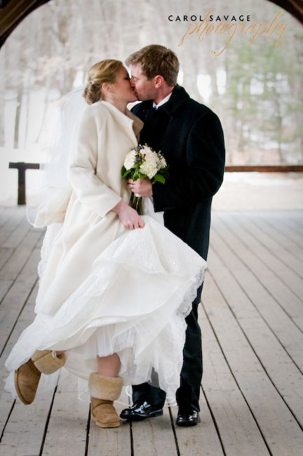 We love this bride\'s simply off-white coat and warm weather boots ...