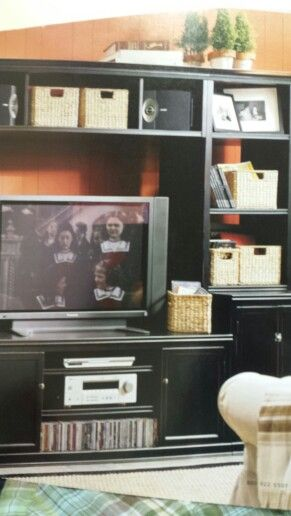 Entertainment Center Decorate With Baskets