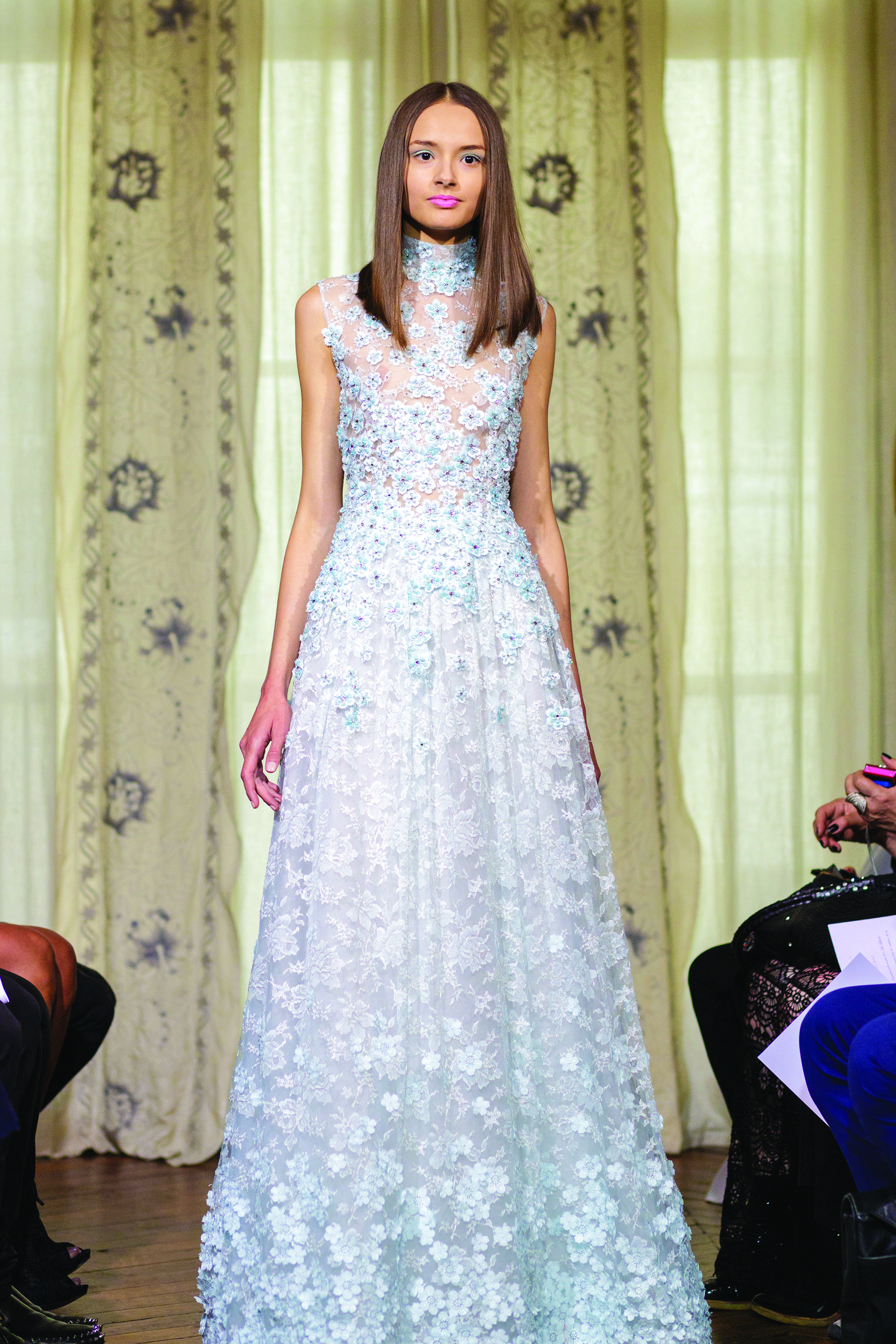 Fashion Designer DANY ATRACHE liberates the woman and gets her rid of the traditional line. Sky blue dress with flowers embroidered
