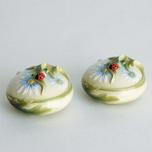 """Franz Porcelain Ladybug salt & pepper shakers by Franz. $127.00. Dimensions: 3-1/4x3-1/4x2. A set of ladybug salt and pepper shakers that feature daisies and a sole ladybug on each shaker. From the Ladybug collection by Franz. LWH: 3-1/4""""x3-1/4""""x2"""""""