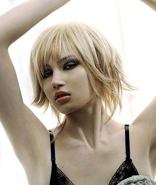 A medium blonde straight choppy hairstyle by Andrew Mulvenna