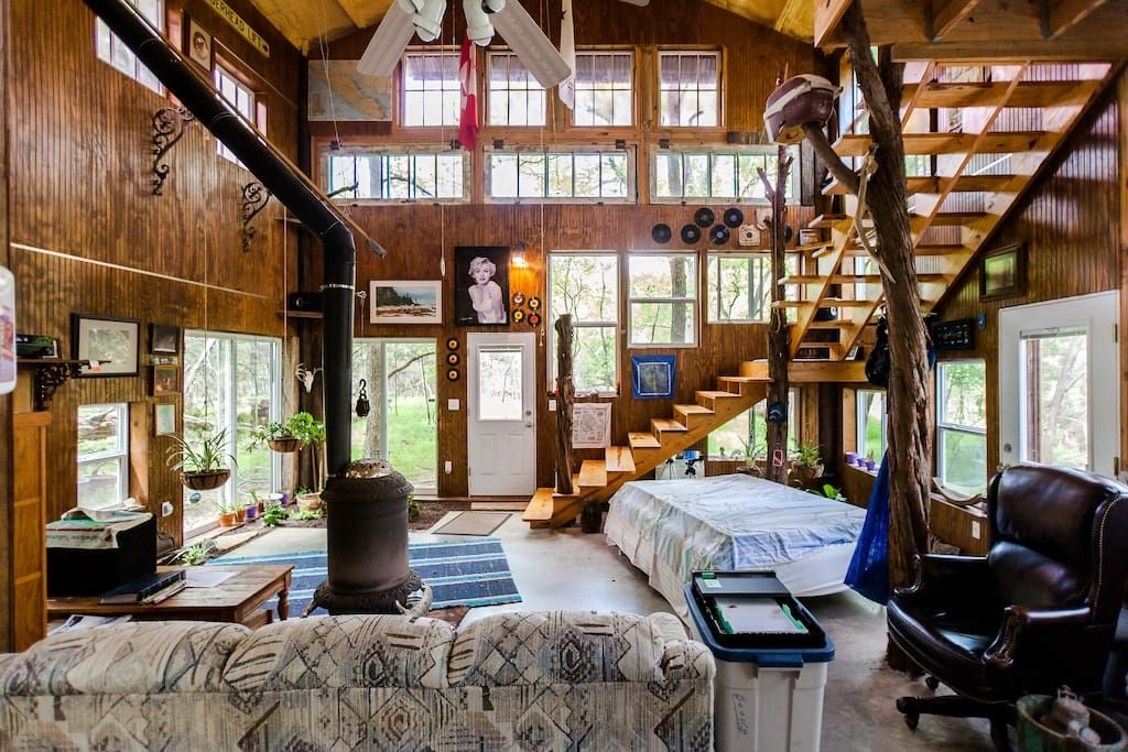 """Treehouse in San Marcos, United States. 2 story Barn/Tree-house on 6 wooded acres.  Wildlife, barn-wood interior, recycled tin exterior, claw-foot tub, wood-burner,  40 windows (7 antique lavender poured glass), outdoor 6 ft metal soak tank, 2nd floor private deck,  43"""" 4G Ultra High De..."""
