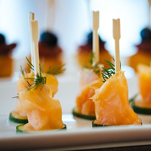 Smoked salmon on a fork. By wrapping the smoked salmon around a fork, you've created an elegant yet simple to eat hors d'oeuvre for holiday entertaining.