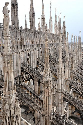 By just looking at this you can tell it is Gothic architecture because of all spirals that lead the eye up and the small design of every one of the spirals and arch. Gothic design is not simple, it is very decorated and complex.