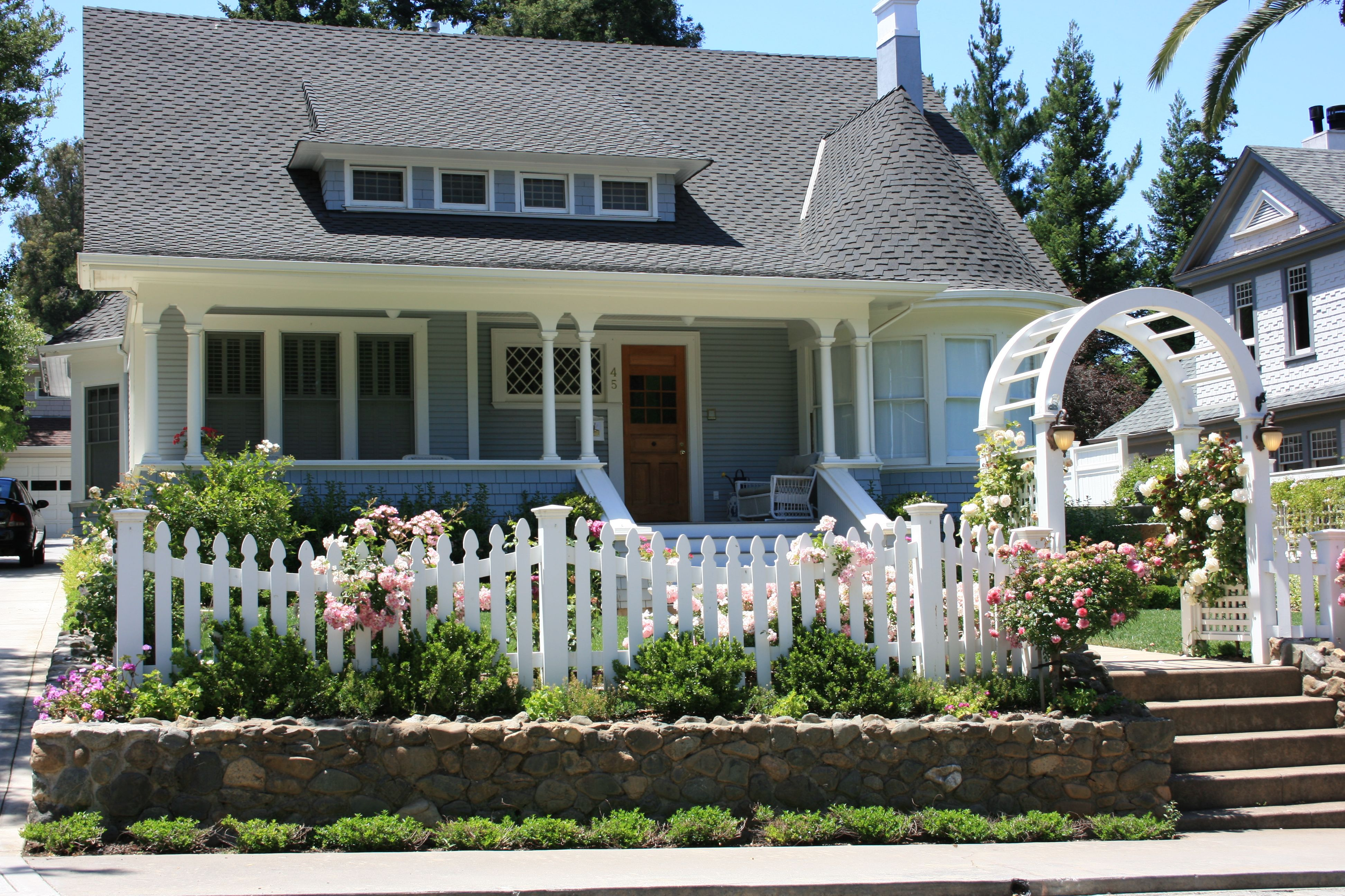 Living The American Dream With A White Picket Fence White