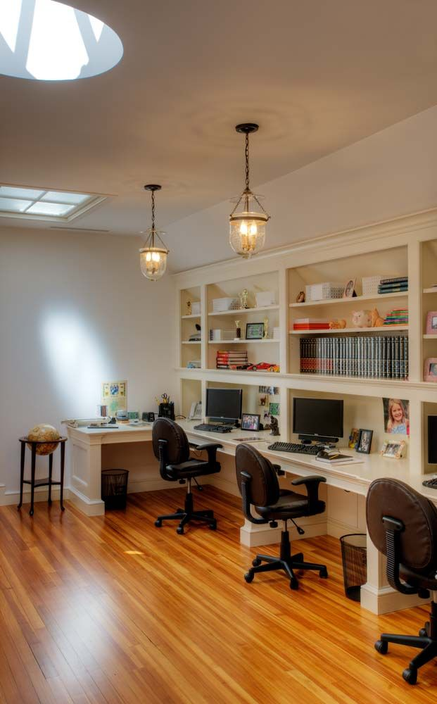 Office area, ideal for a large family with lots of kids and multiple computers.  Skylights, hanging pendants and a beautiful wood floor create an inviting space to get things done.