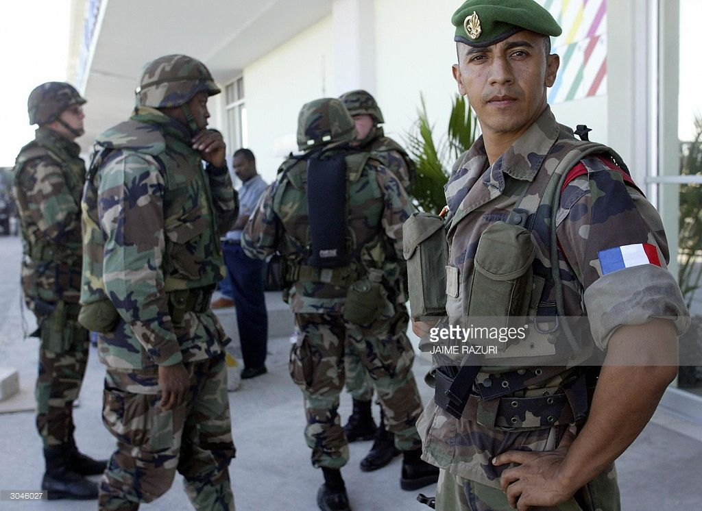 A soldier member of the French Foreign Legion (R) stands