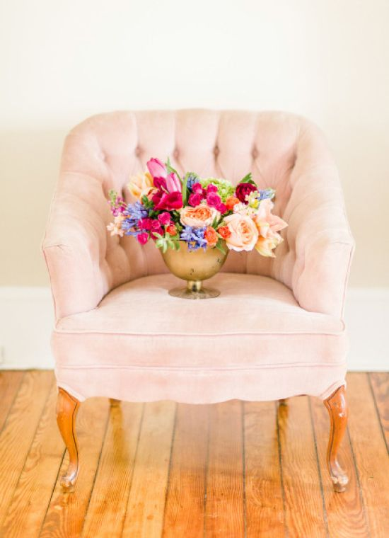 Can't decide what we love most here - the beautiful floral arrangement or the #pink #vintage chair! {Rachel May Photography}
