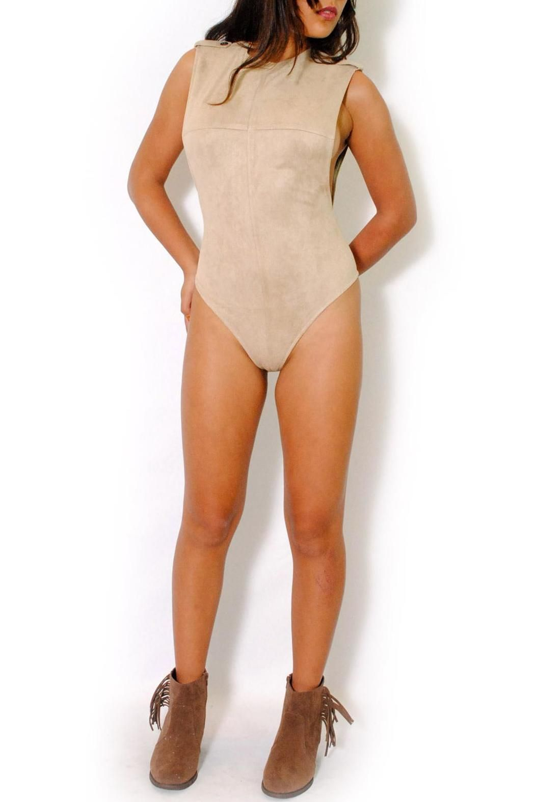 170a1e3f5b Surely you ll be the trendsetter to follow wearing this vegan suede bodysuit  by rehab brand. Exposed back zipper. Round neck. Clip buttons closure.