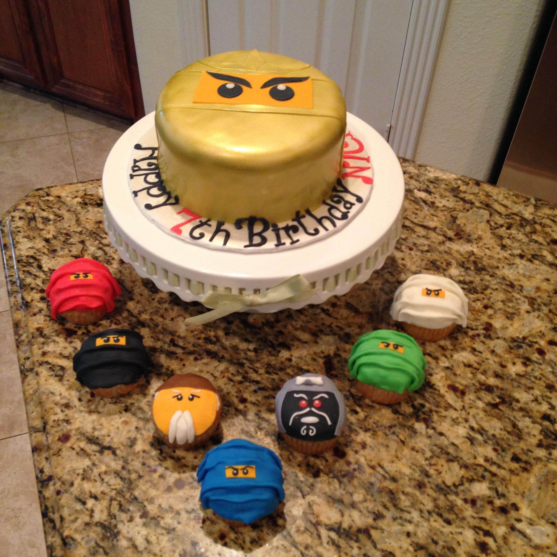 Golden ninjago chocolate cake and vanilla ninja cupcakes.  https://www.facebook.com/sweetnsassycakesbyeva