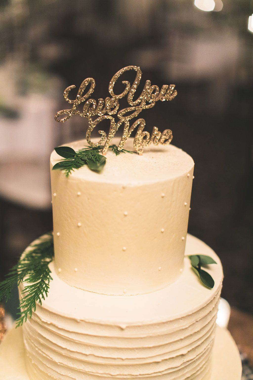 gold cake topper - photo by Justin Johnson Photography http://ruffledblog.com/glam-cabin-in-the-woods-inspired-wedding