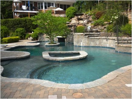 Custom Gunite Pool With Multi Tiered Natural Waterfall Grotto Length Of Raised