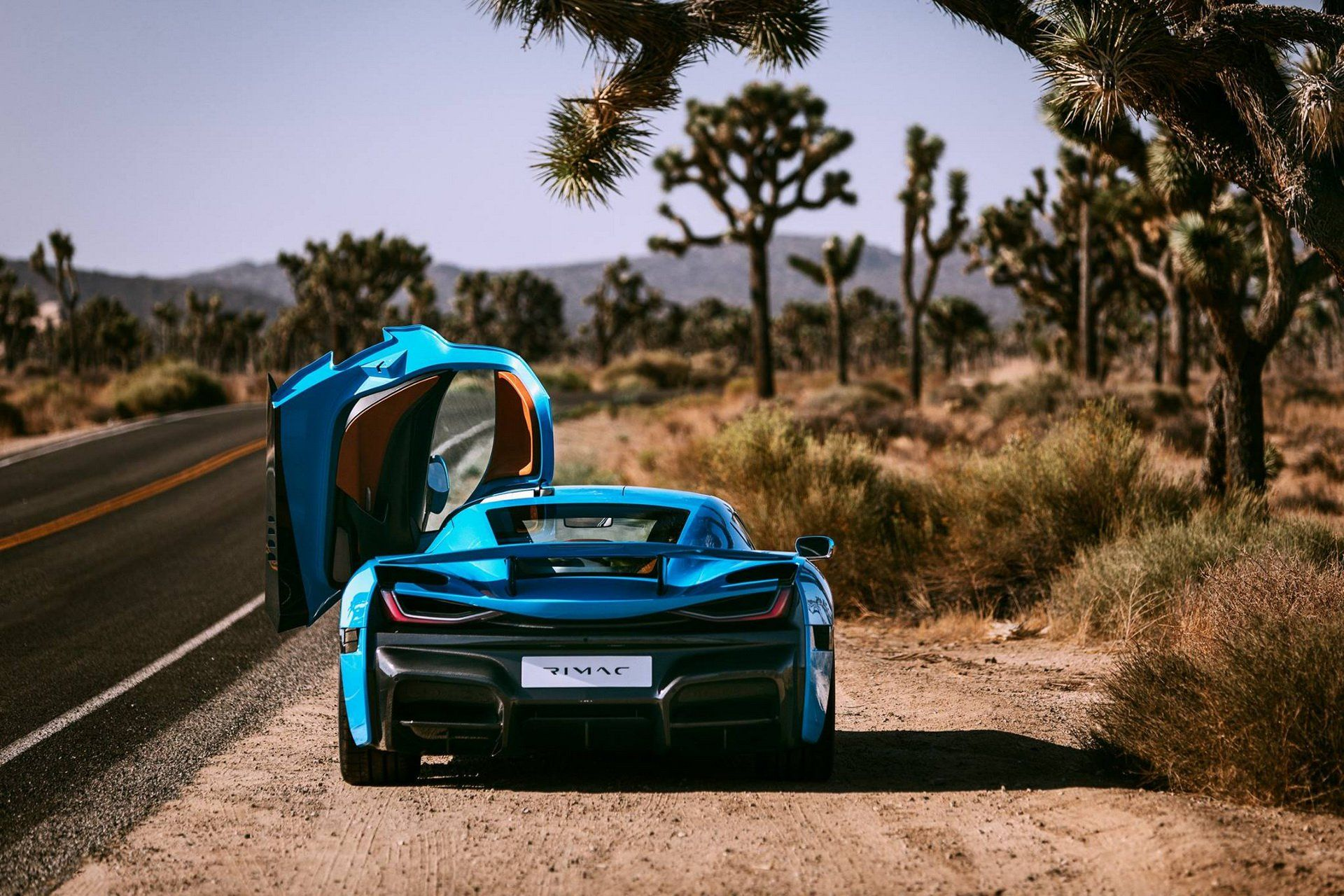 Rimac S 1 888 Hp C Two Electric Hypercar Gets New Paintjob Two Champagne Bottles And Flutes Carscoops Car Wallpapers Automotive Super Cars