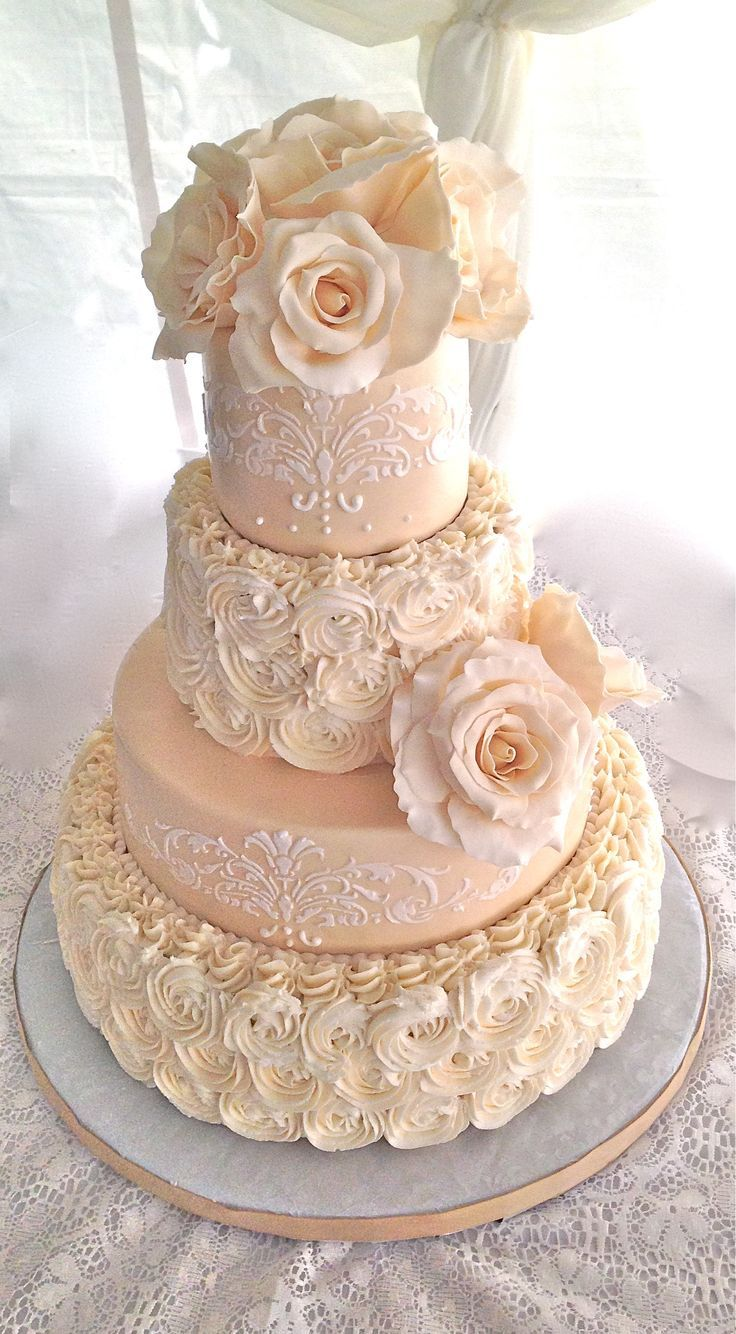 Piped rosette wedding cake with sugar flowers and lace