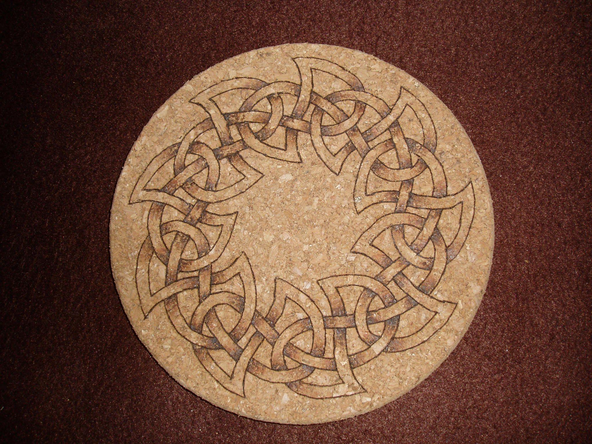 Celtic knot ring on cork mat