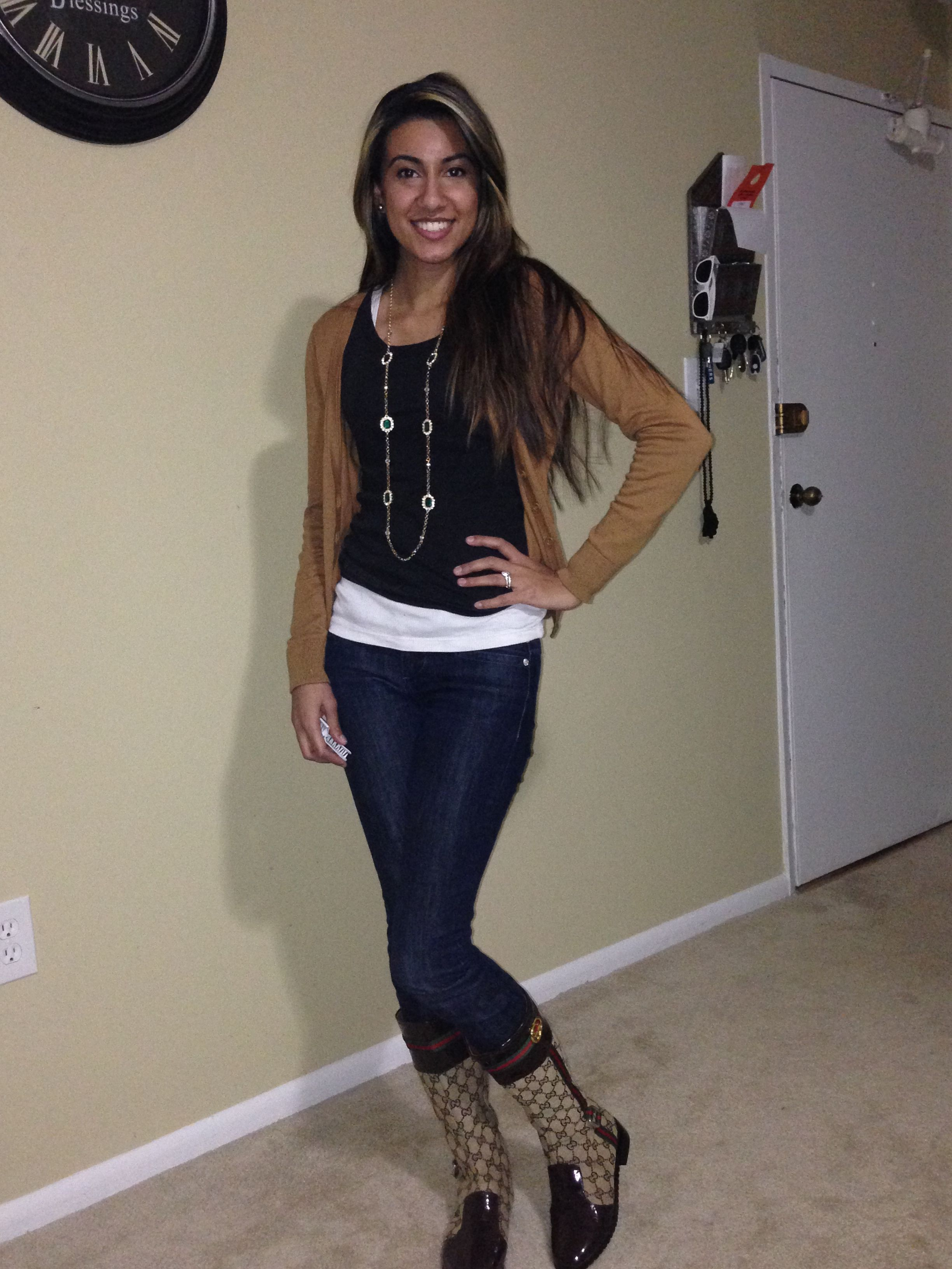 Brown outfit. Black shirt. Gucci boots. Emerald necklace