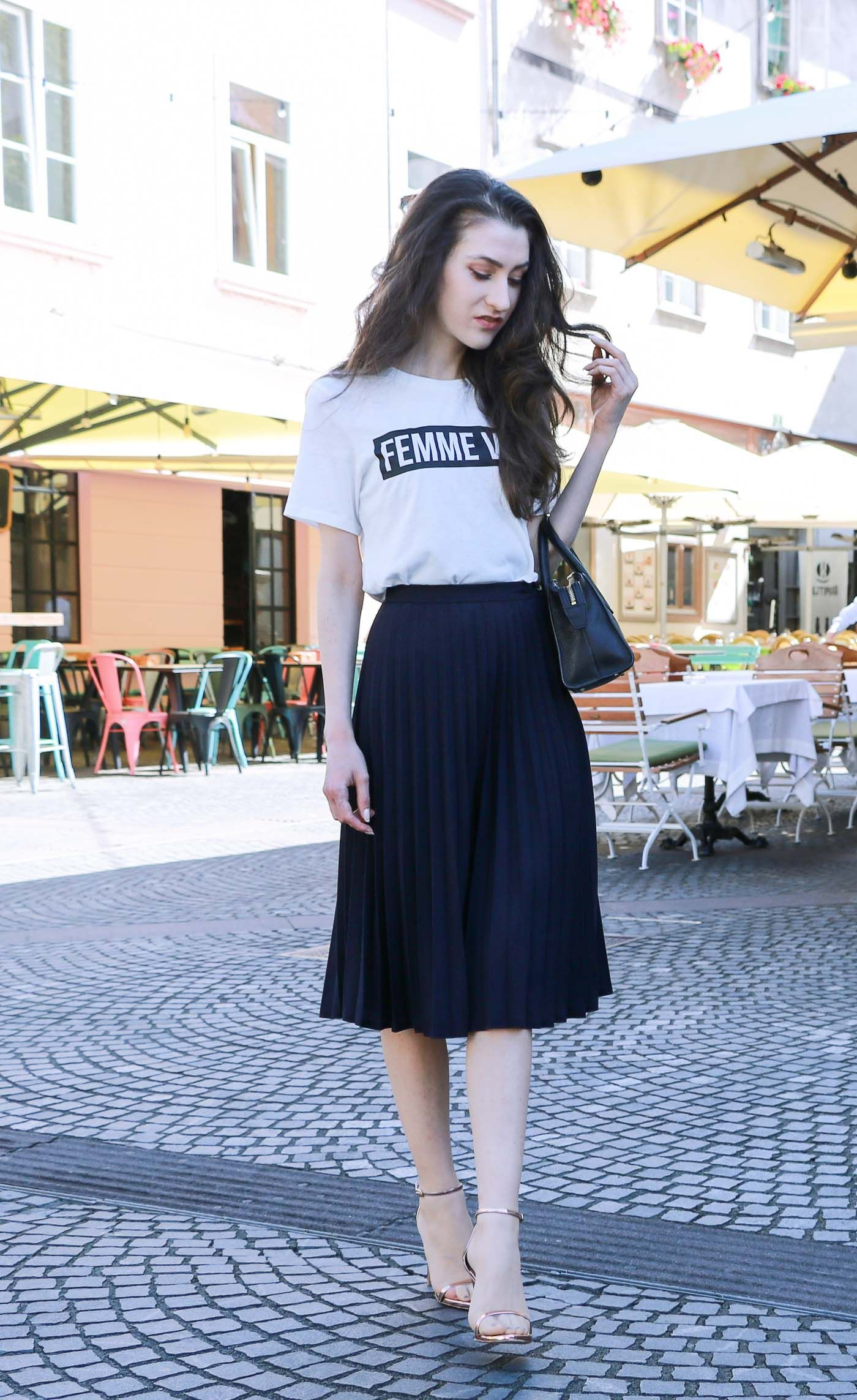 a73fb8676c Fashion Blogger Veronika Lipar of Brunette from Wall Street on how to style  pleated midi skirt now