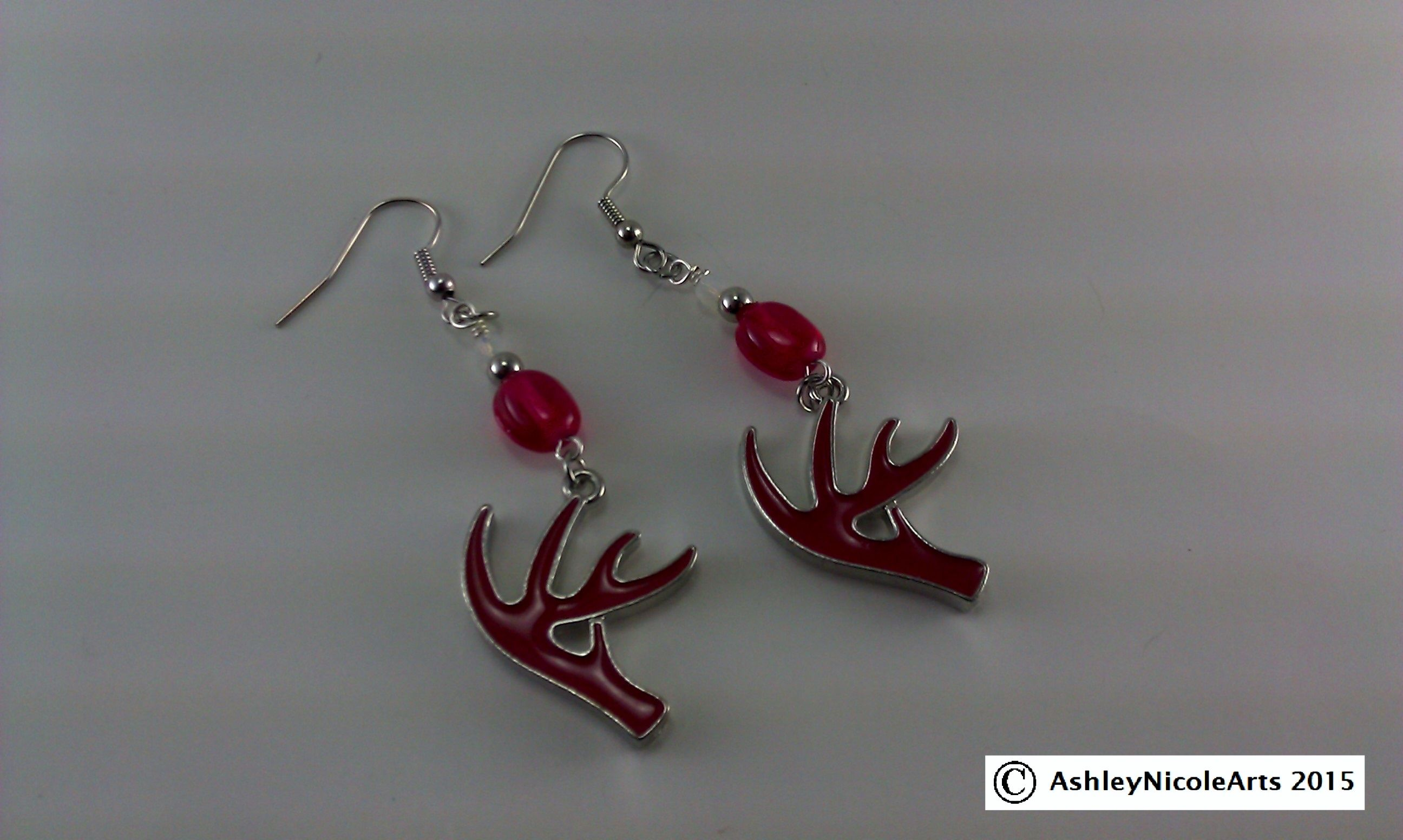 Coming soon! Red browning deer antler earrings! Check out my facebook page for more! Thanks for looking!  https://www.facebook.com/AshleyNicoleArts