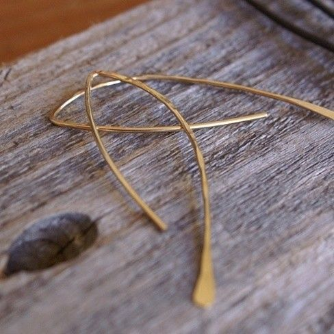 """These exquisite handmade gold-filled wire earrings by Balsamroot Jewelry add a beautiful touch to just about any look! Formed and hammered into a unique and lovely free-form feather shape, they measure 2.25"""" in length and are handcrafted with care from one of our favorite jewelry designers."""
