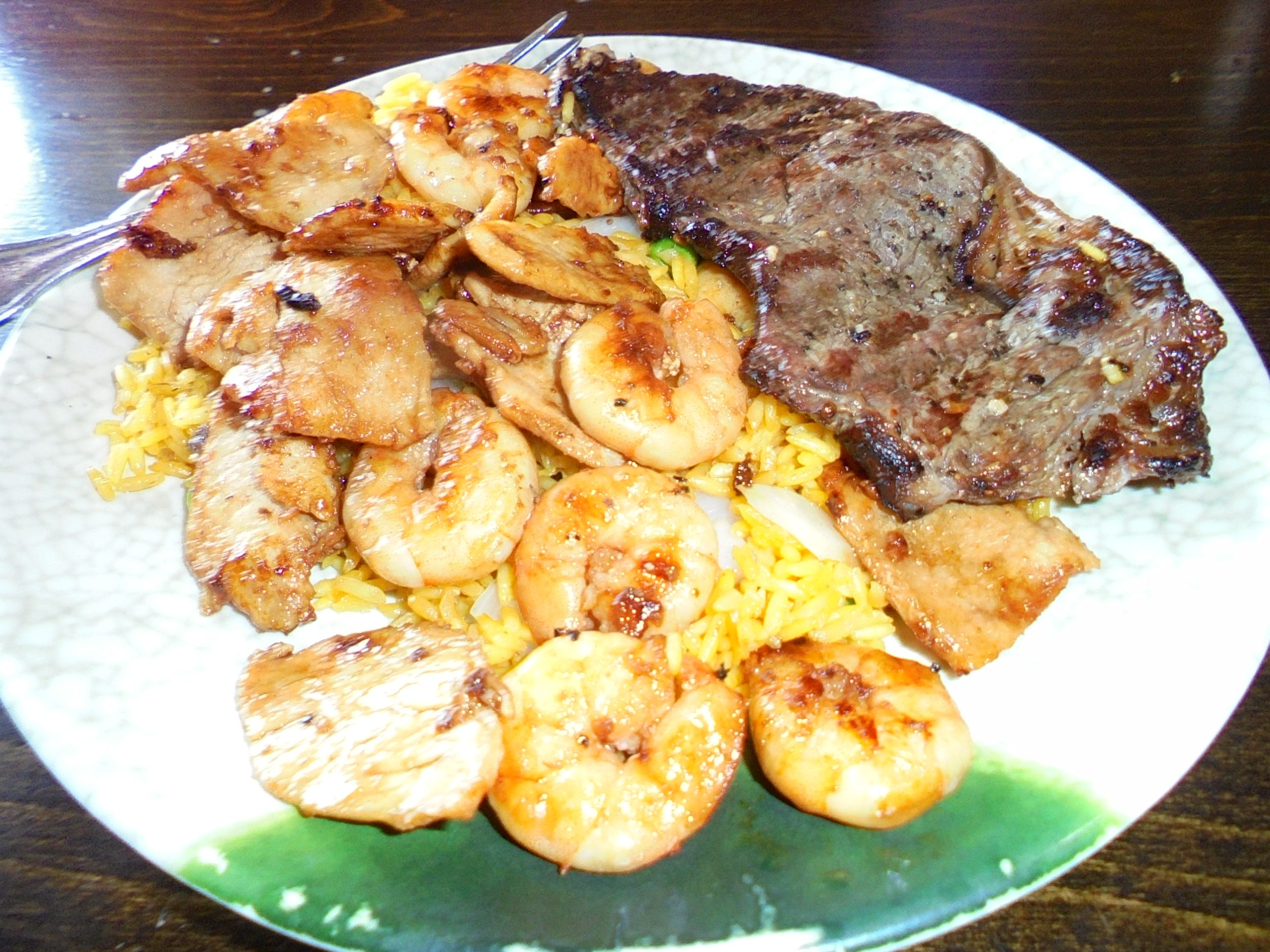 #Shrimp, #GrilledSteak, and #Chicken in #Hibachisauce over #friedrice and #onions - www.drewrynewsnetwork.com