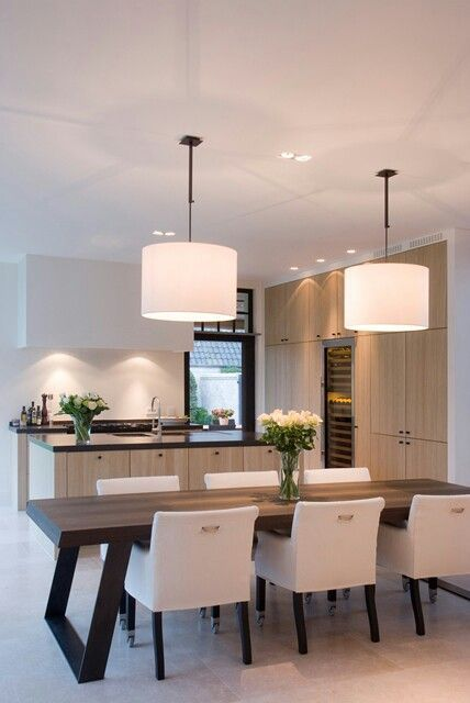 modern kitchen designno upper cabinetswall of storagependant lighting over table