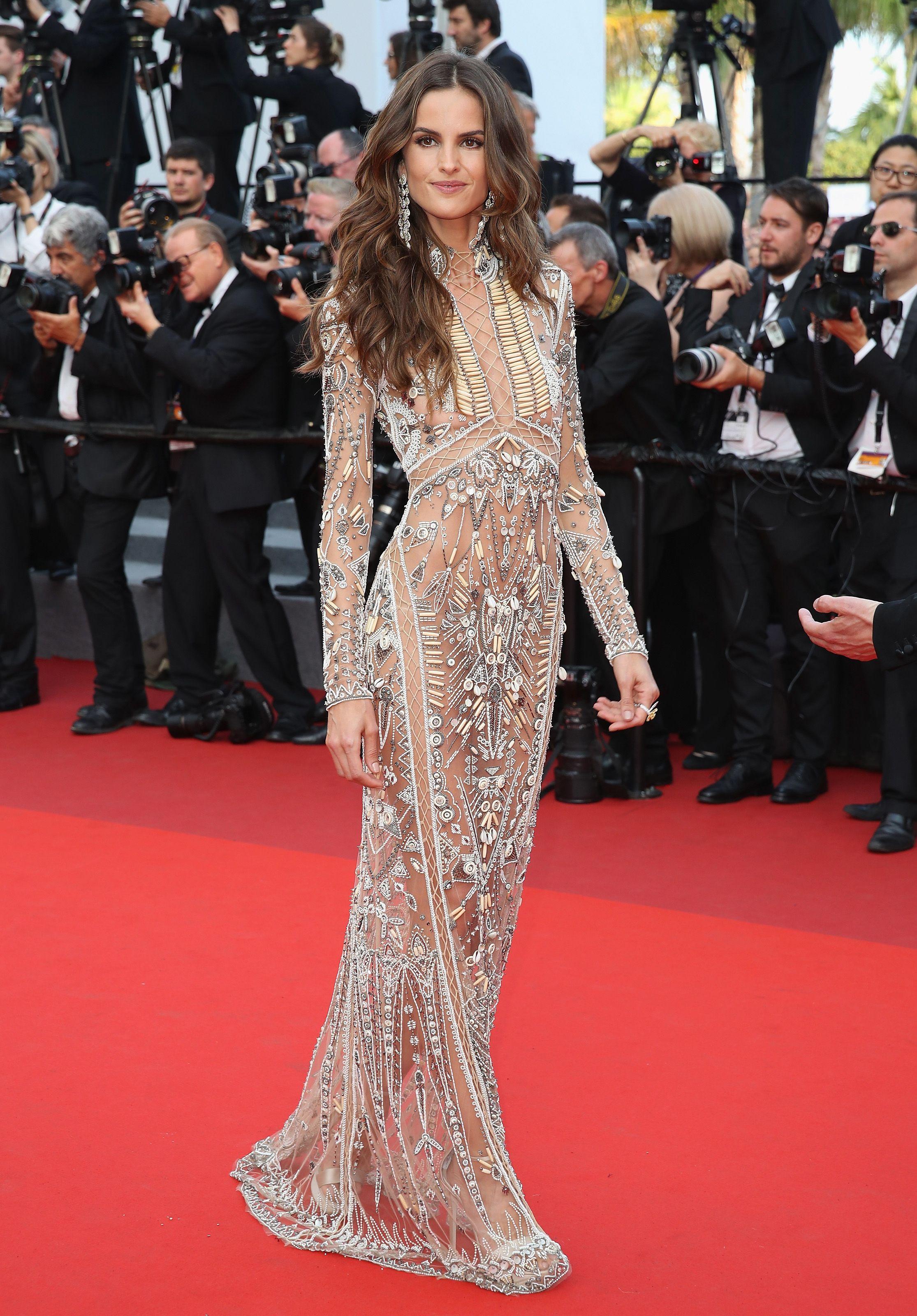 IzabelGoulart wearing a high neck, long sleeve, transparent gown ...