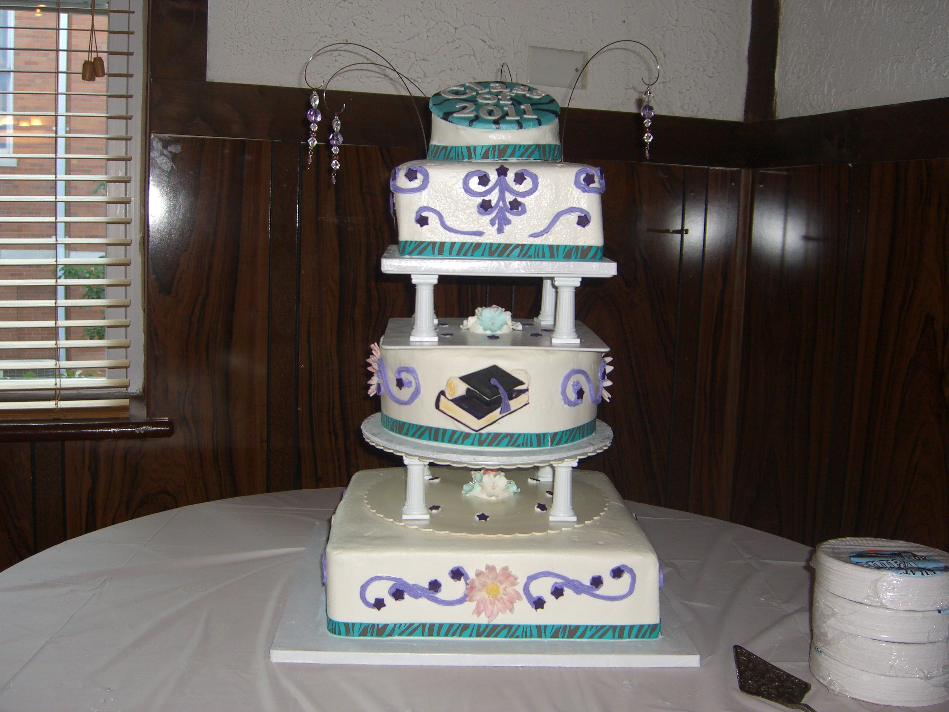 High School Graduation - Buttercream covered cake, cookies and cream filling. Top litle cake covered in fondant.