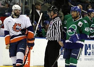 Blair Riley, who played much of last season with the Bridgeport Sound Tigers, had been re-signed by the New York Islander's organization.