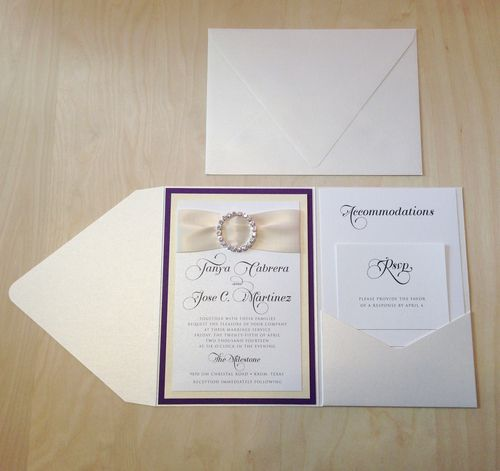 Custom wedding invitation on ivory pearlescent and plum with ribbon and rhinestone accent in pocket folder.