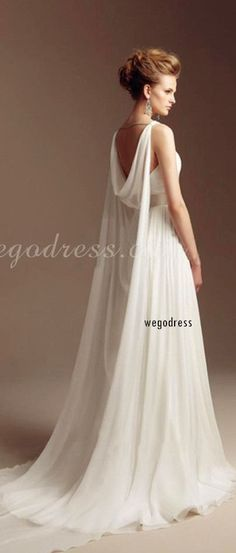 A fairly unique bridal gown. Cool design, love the flowing lines of the cape and…