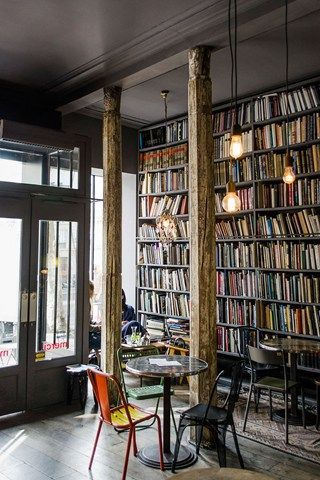 Paris in Photos The Used Book Cafe is a dark and moody café located in the fantastic concept store Merci, at 111 Boulevard Beaumarchais 75003.The Used Book Cafe is a dark and moody café located in the fantastic concept store Merci, at 111 Boulevard Beaumarchais 75003.