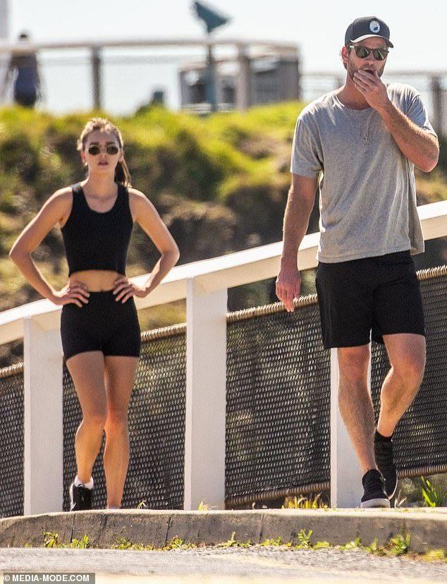Apart: Showcasing her slender frame in a black singlet and matching bike shorts, model Gab...