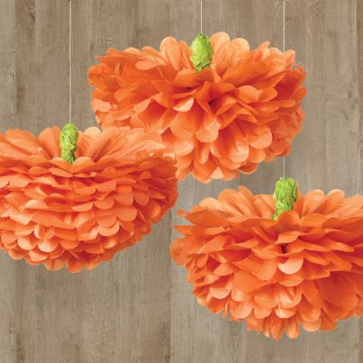 These pumpkin tissue pom poms are the perfect decoration for - halloween party ideas decorations