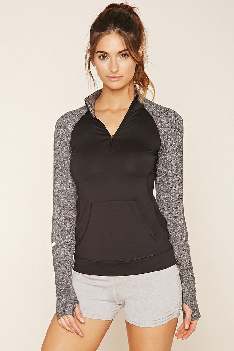 A knit athletic jacket featuring reflective strips on the