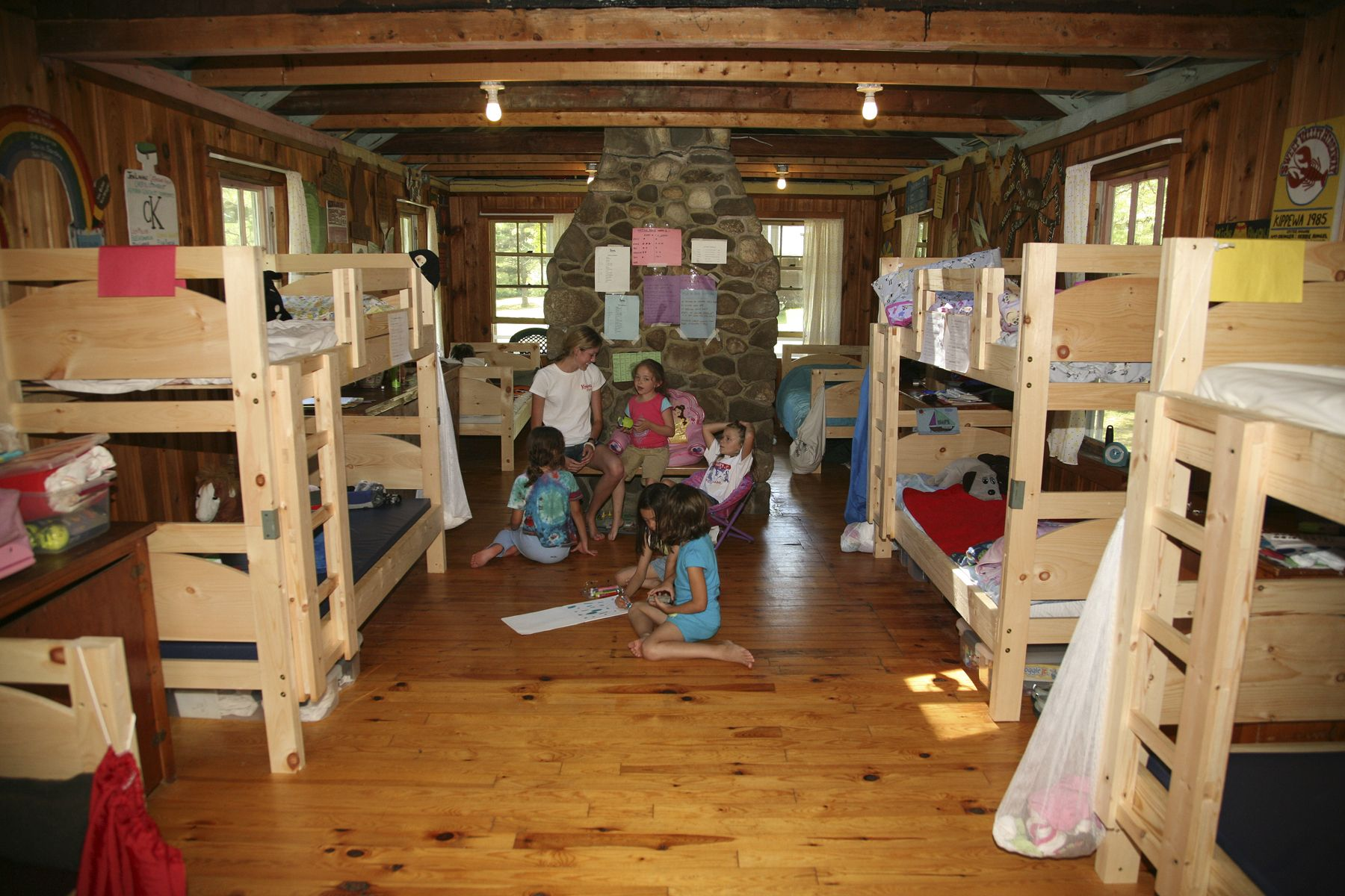 Kippewa girls and counselors enjoying time together inside one of our bunks.