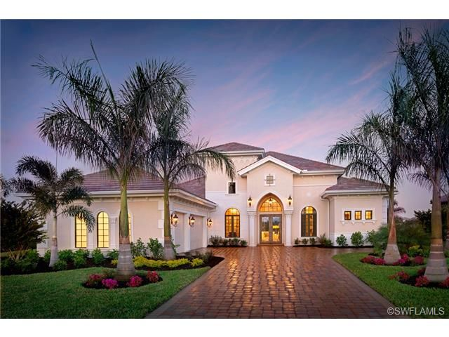 Mediterranean Home In Naples Florida Gothic Arches Palm Trees Stucco Stone Driveway Mediterranean Homes Spanish Style Homes Mediterranean Homes Exterior