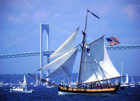 """The 110 foot Providence sails past Newport Bridge during Tall Ships Newport Salute 2000. Providence is a replica built in 1976 of one of the most historic ships of the American Navy, the sloop Katy, the first vessel selected for the Continental Navy and the first command of John Paul Jones, who nicknamed it """"Lucky Sloop."""""""