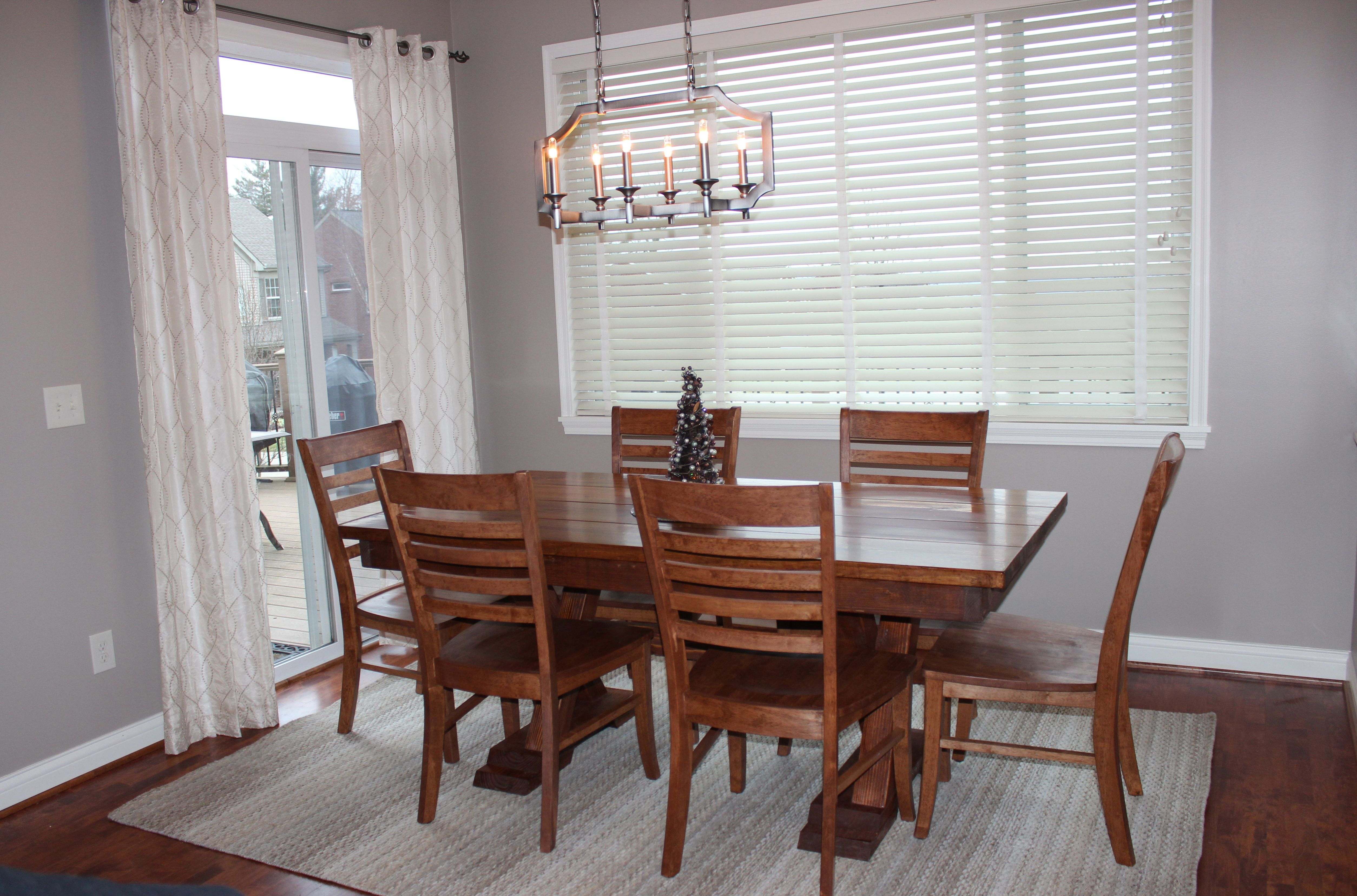 James+James 6 foot Trestle table stained in Dark Walnut with matching Thomas Dining Chairs.