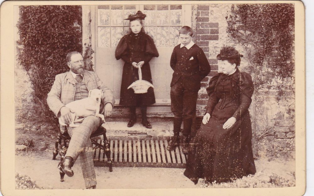 ANTIQUE CABINET PHOTO. FAMILY GROUP OUSIDE HOUSE WITH PET DOG ON MASTRS LAP