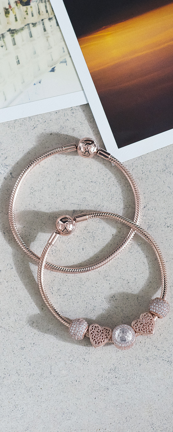 c0797ca39 Putting a soft spin on a classic design, this smooth snake-chain bracelet  in PANDORA Rose brings femininity to minimalism. Play with PANDORA Rose  charms to ...