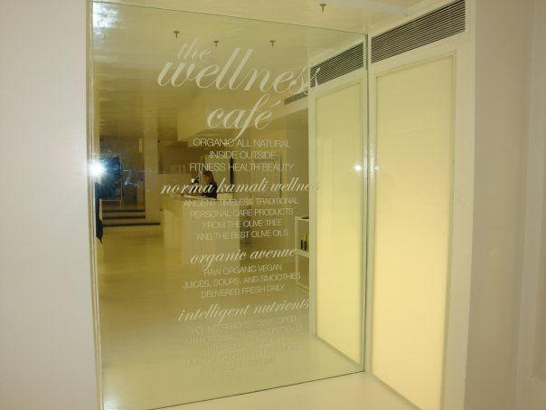 custom opaque white vinyl lettering applied onto glass mirror in nyc for more information on