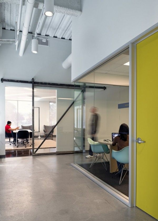 glass wall offices meeting rooms concrete floor sliding door yellow high ceilings exposed services office ideas l8 office